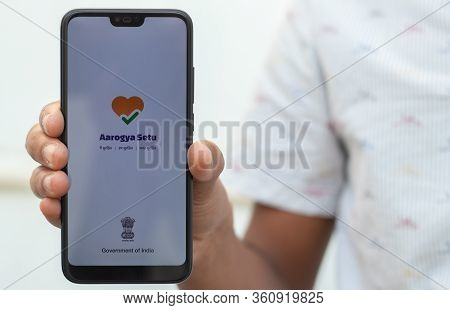 Maski, India-12, April 2020 : Hand Holding Aarogya Setu App Launched By Government Of India For Self