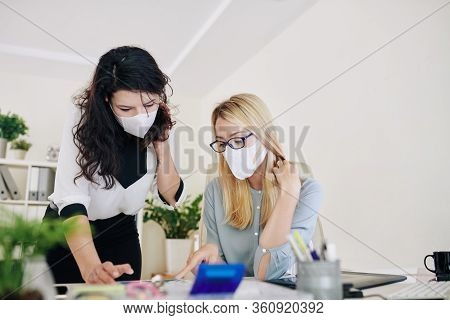 Businesswomen Working In Office And Wearing Surgical Masks To Prevent Outbreak Of Corona Virus Or In