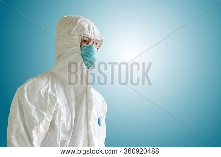 Medical Personnel In Half Protective Clothing Uniform Ppe Suit And Surgical Mask Or Hygienic Mask N9