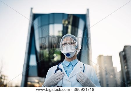 Coronavirus Doctor Standing In Front Of Modern Clinic Building,working In The Isolation Ward.medical