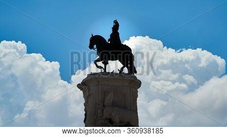 Lisbon, Portugal - November 2019: Silhouette Of Equestrian Statue Of King John I In The Praca Da Fig