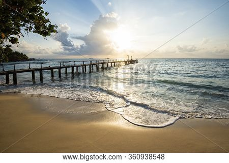 Amazing Sandy Tropical Beach With Silhouette Wooden Bridge Out Of The Beach Tropical / Boardwalk Or