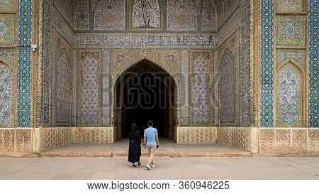 Shiraz, Iran - May 2019: Unidentified Couple Walking Towards The Prayer Hall Of Vakil Mosque, Shabes