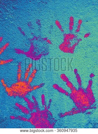 Multi-colored Hand Prints Smeared With Paint On Wall