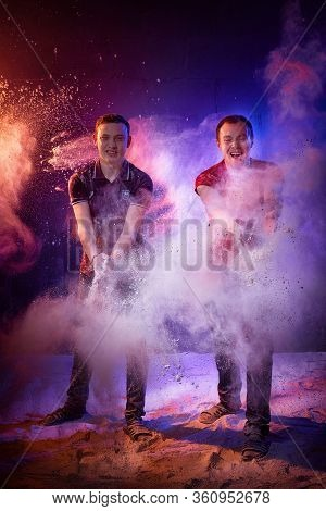 Kirov, Russia - Januray 06, 2020: Funny Man Or Young Guy In Studio In A Photo Shoot With Loose Flour