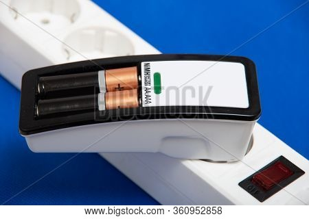 Charger With Two Lithium-ion Aa Aaa Batteries Inserted Into The Charger