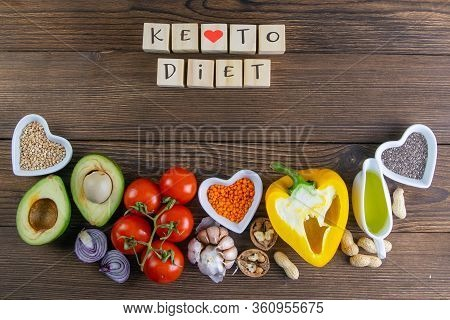 Keto Diet. Vegetables Seeds And Nuts Are Lined Up With Wooden Cubes On Which The Keto Diet Writes. T