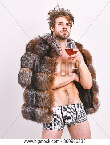 Rich Athlete Enjoy His Life. Sexy Sleepy Rich Macho Tousled Hair Drink Wine Isolated On White. Fashi