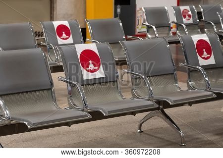 Red Distance Sign On Chairs In The Waiting Room Of The Station