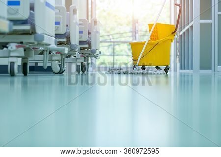 Cleaner Using Mops, Cleaner With Mop And Uniform Cleaning Hall Floor, Hospital Cleaning Floor With M