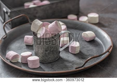 Metallic Vintage Tray, Surface And Cup With Pink And White Marshmallows Inside The Cup And Scattered