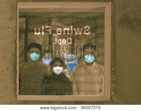 People outside Swine Flu department in a hospital, H1N1 poster