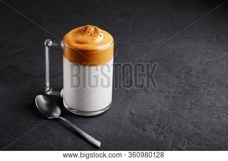 Dalgona Coffee In A Transparent Cup At Black Slate Table Top. Dalgona Frothy Coffee Is A South Korea