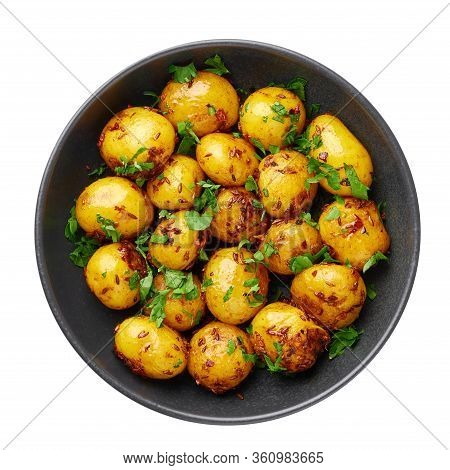 Jeera Aloo In Black Bowl Isolated On White Background. Jeera Aloo Is Indian Cuisine Dish With Baby P