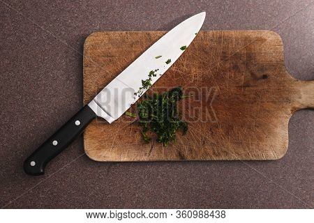 Healthy Plant-based Food Ingredients Concept, Parsley Herb Roughly Chopped On Chopping Board Next To