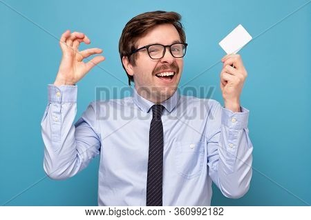 Man Show Small Size By Fingers Hodfing A Credit Card, Demonstrate Tiny Measure