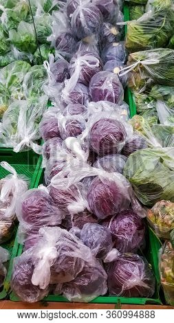 Vegetables Sold In Plastic Bags To Prevent Coronavirus Spread On Supermarket Racks. Protection And P