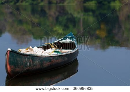 A Boat Or Canoe In The Still Waters Of The Periyar River In The South Indian State Of Kerala.