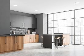 Corner Of Modern Kitchen With Gray And Brick Walls, Concrete Floor, Wooden Countertops With Built In