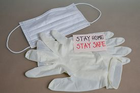 Medical Mask And Medical Gloves On The Table. Medical Concept Stay Home-stay Safe