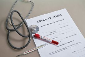 Medical Certificate After The Positive Test For Covid-19. Medicine Documents With Stethoscope, Therm