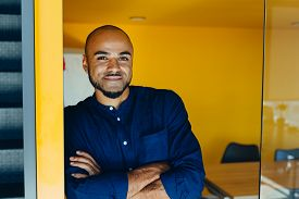 Happy African American Businessman Entrepreneur Startup Owner Stand In Modern Office Looking At Came