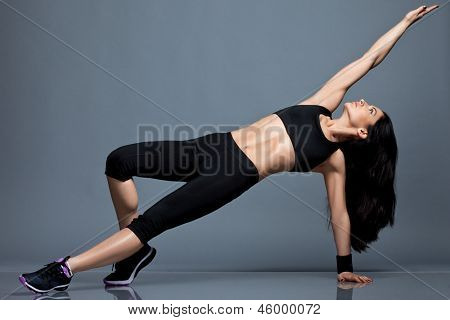 Athletic girl in sport clothes poster