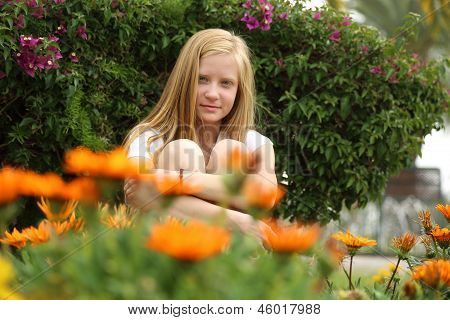 Cute blonde girl at the wildflowers