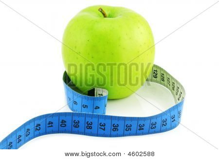 Bright green apple and measuring tape isolated on a white background poster