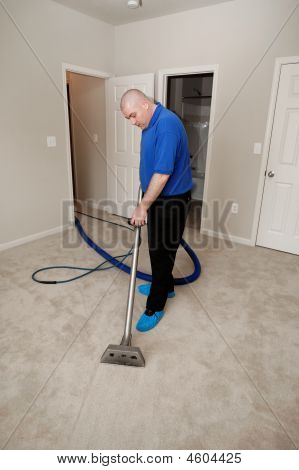 Man cleaning carpet with commercial equipmentcompany does a lot of homes and apartments poster