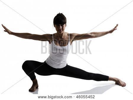 portrait of sport girl doing yoga stretching yoga exercise, studio shot in silhouette technique over white