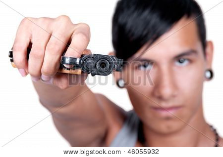 Hispanic Man Pointing Gun At Camera