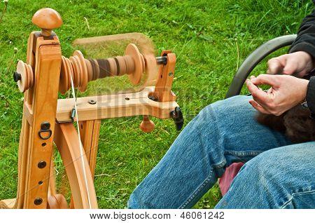 Closeup Of Hand Spinning Wool