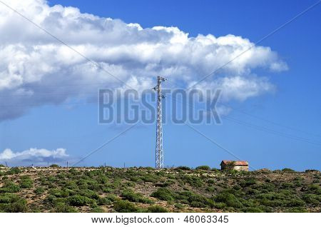 Transmitter Tower In Green Field On Sunny Day
