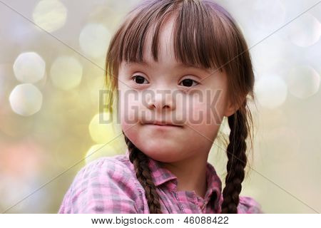 Portrait Of Happy Young Girl In The Park