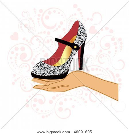Sparkle shoe in hand