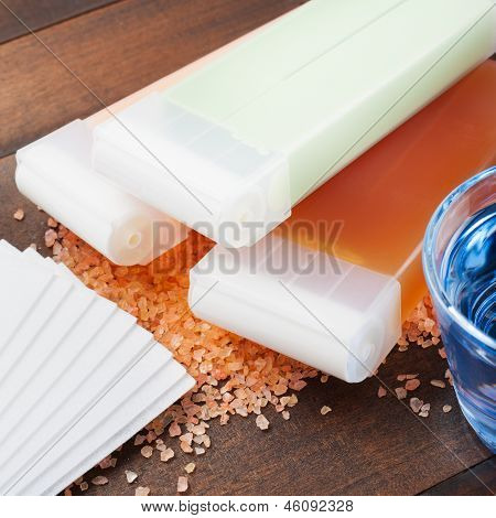 Wax For Hair Removal And Oil On Wooden Table