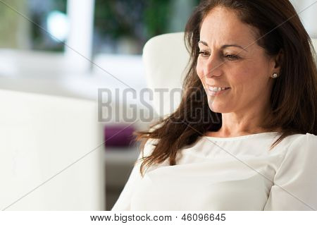 Happy Mature Woman Working On Laptop, Indoors