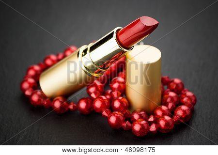 red  jewelry lipstick on black