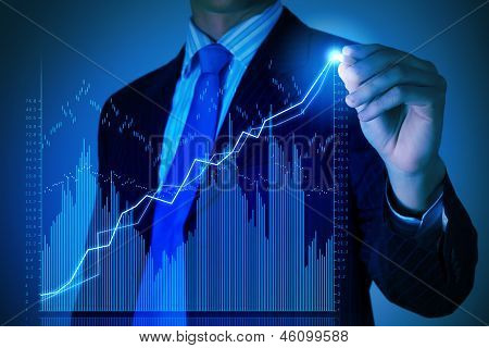 Business man drawing graphics