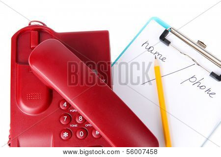Telephone and notepad and other items, isolated on white