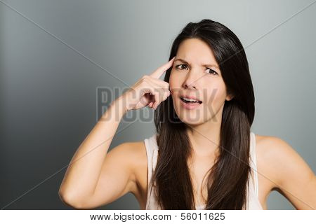 Young Woman Signaling With Her Index Finger