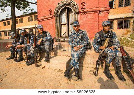 KATHMANDU, NEPAL - Oct 19: Unknown nepalese soldiers Armed Police Force near the public school, Dec 19, 2013 in Kathmandu, Nepal. Armed Police Force tasked with counterinsurgency operations in Nepal.