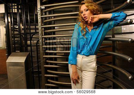 Glamor model posing by entrance with revolving door