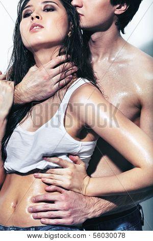Portrait of wet passionate couple