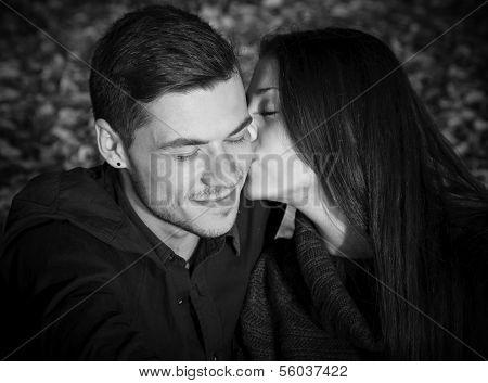 She Kisses His Cheek