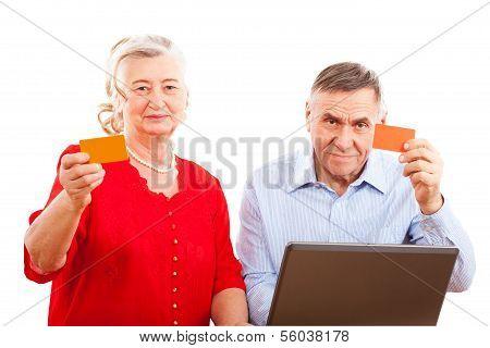 elderly couple doing online shopping