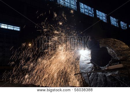 Welder in a steel factory