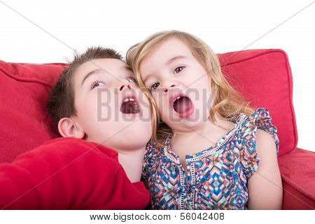Two Playful Young Children Pulling Faces