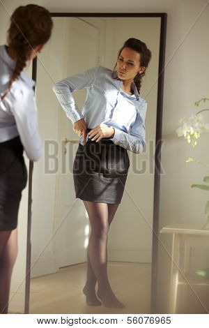 Beautiful Young Businesswoman Getting Dressed
